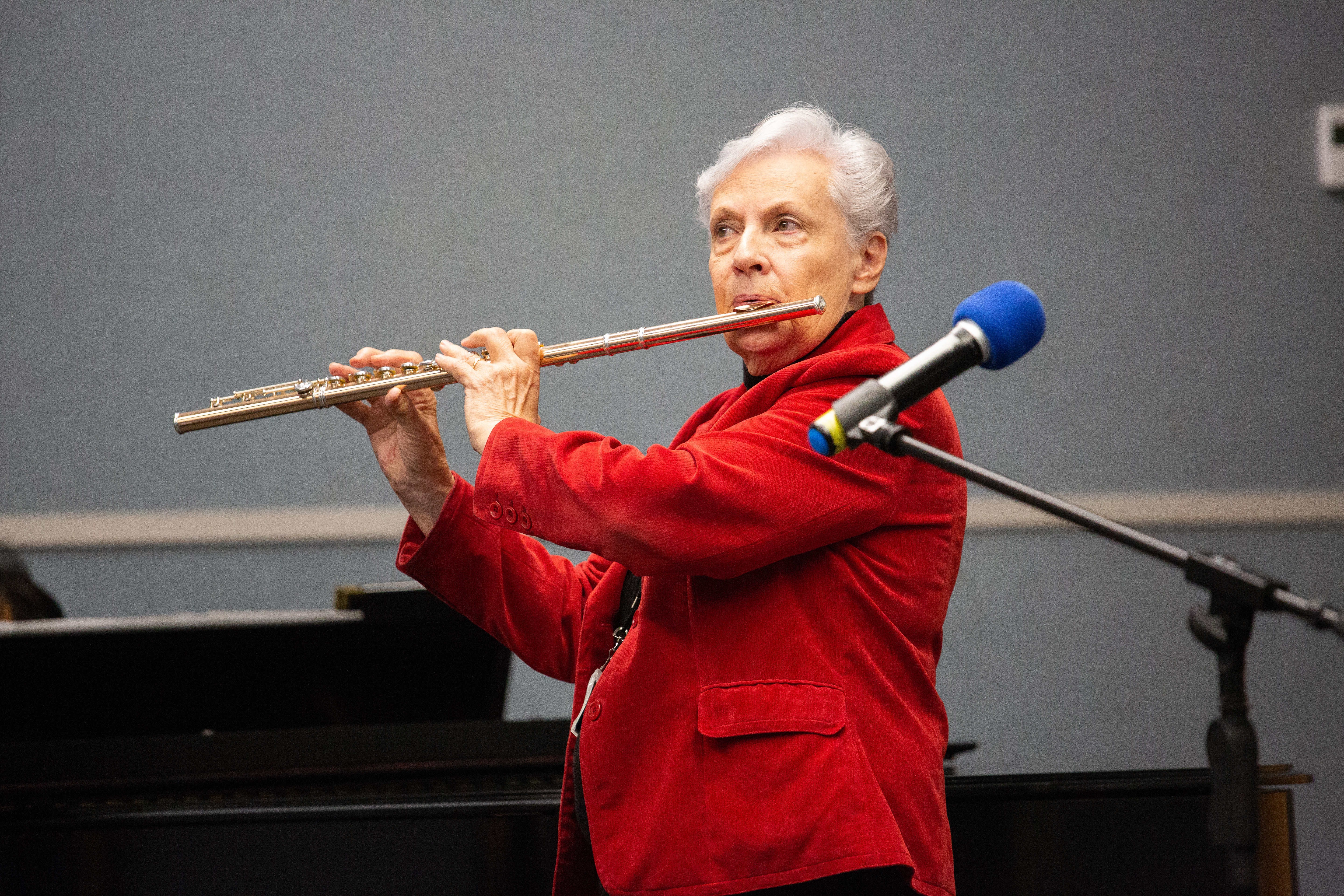 Lilya Wagner, director of PSI, plays her flute for the worship service on National Philanthropy Awareness Day.