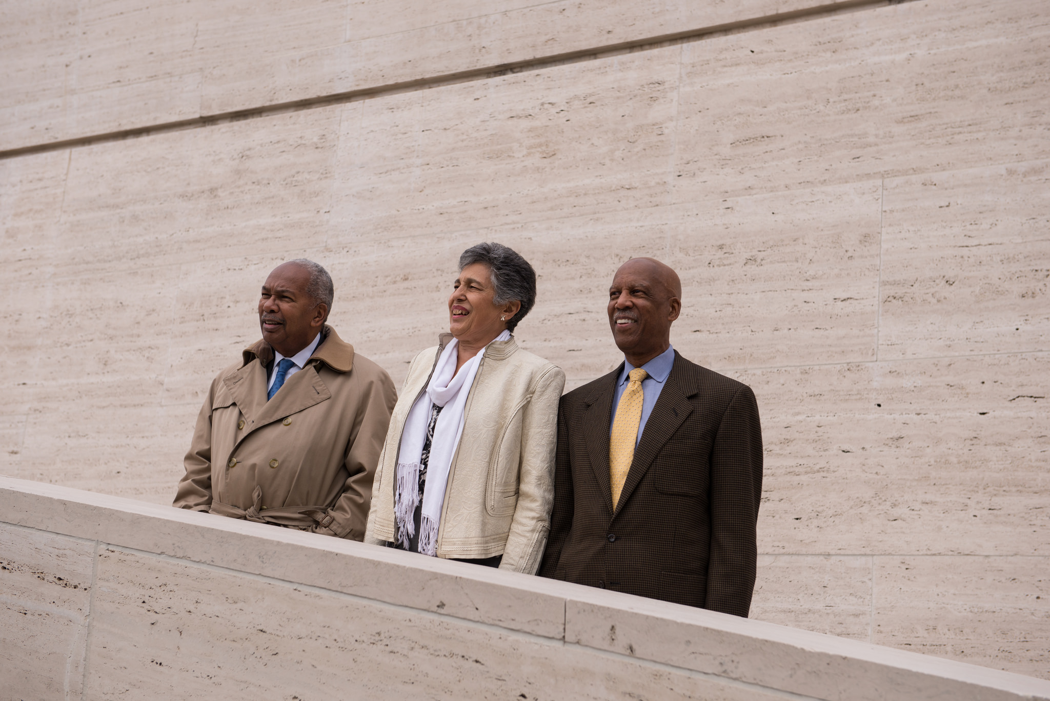"Three members of the ""Little Rock Nine"" - Ernest Green, Carlotta Walls LaNier, and Terrence Roberts - stand together on the steps of the LBJ Presidential Library on November 13, 2014. Photo by Lauren Gerson."