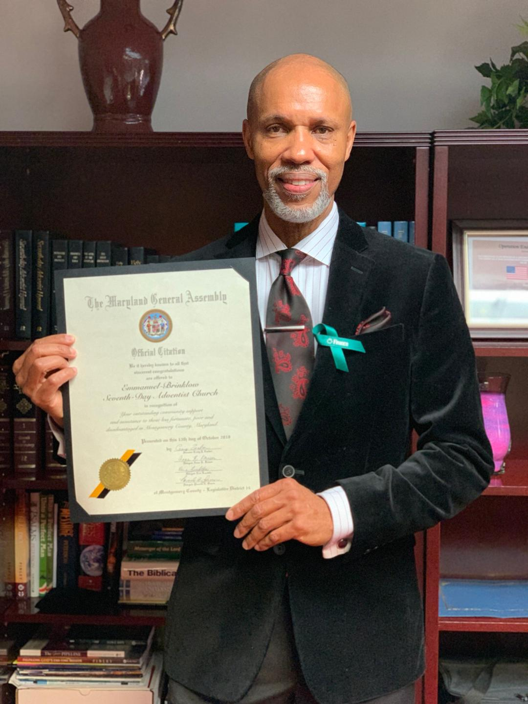 Emmanuel-Brinklow Pastor Anthony Medley displays the citation from the Maryland General Assembly. (Photo: Sheldon Kennedy)