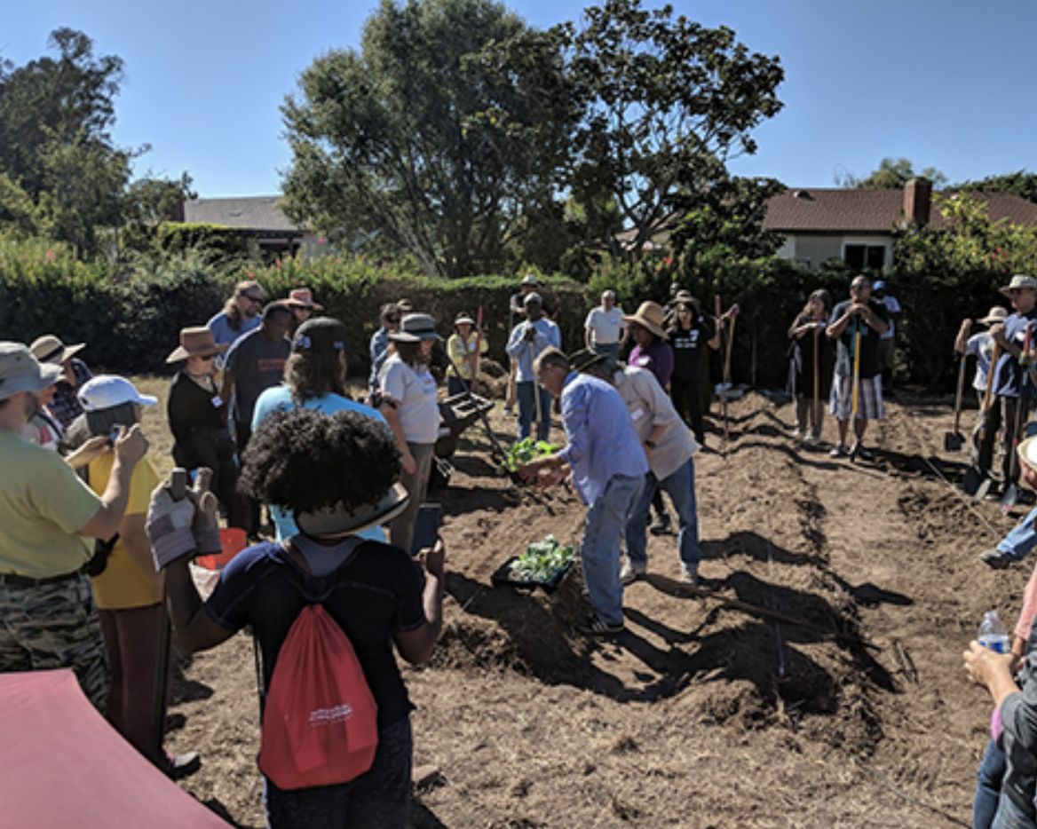Hoag gives planting instructions to the community and church members who showed support for a community garden by attending the first garden workshop in fall 2018.