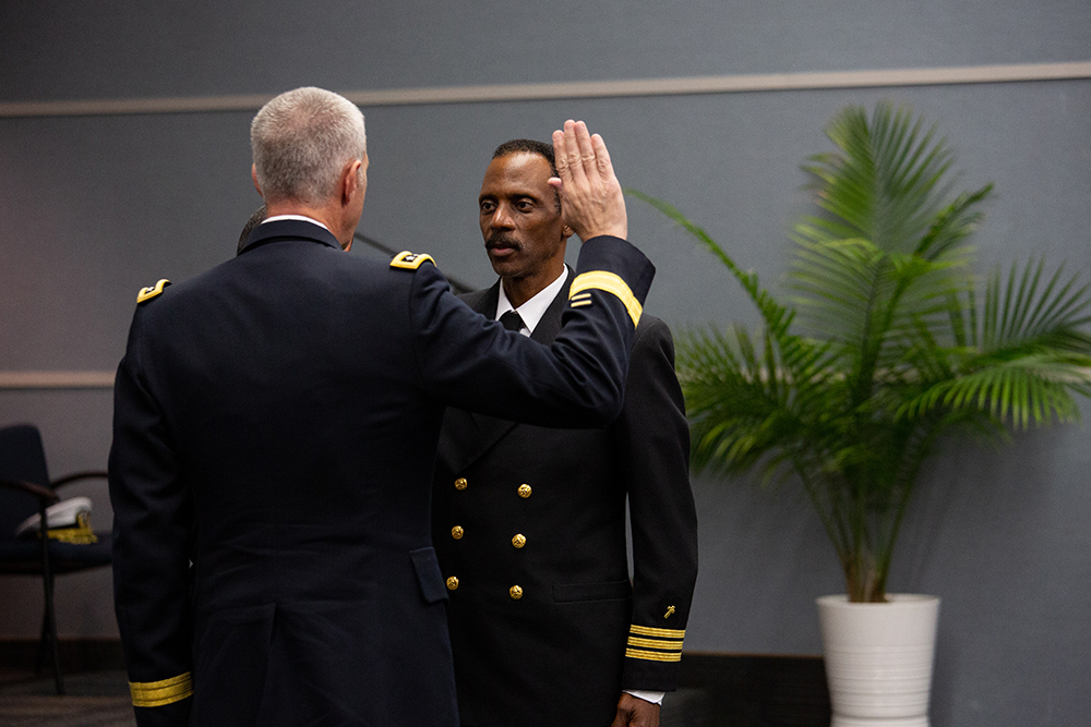 Lt. General Reynold Hoover presents Washington Johnson, II with the oath of office as part of the promotion ceremony.