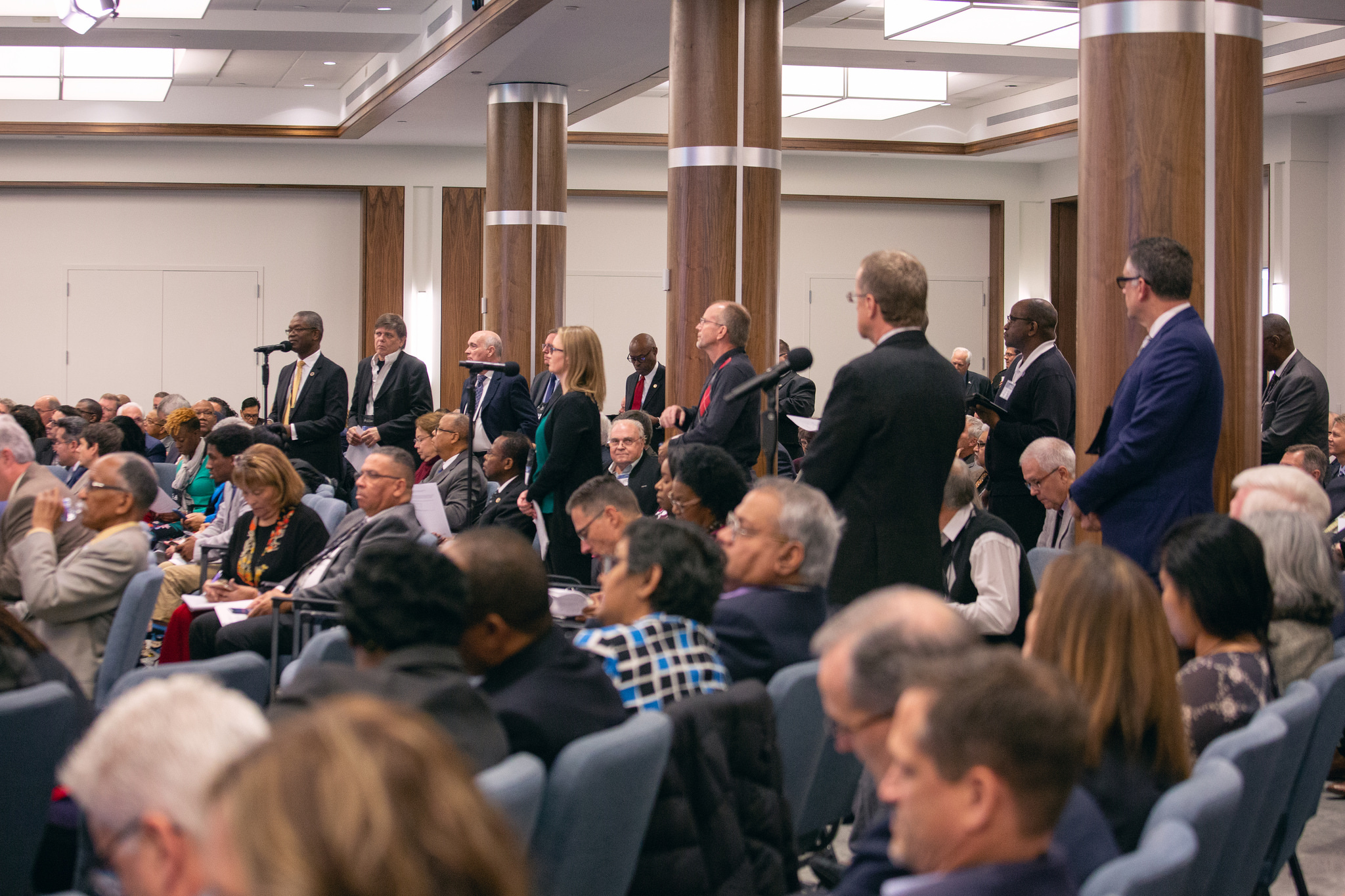 NAD executive committee members line up to speak during the morning discussion on the GC document voted at Annual Council that sets forth the creation of a new compliance process to assist with the need to implement church policies and voted actions.
