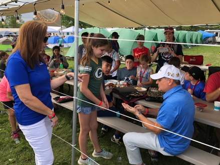 AdventHealth president/CEO Terry Shaw trades pins at 2019 Oshkosh Camporee