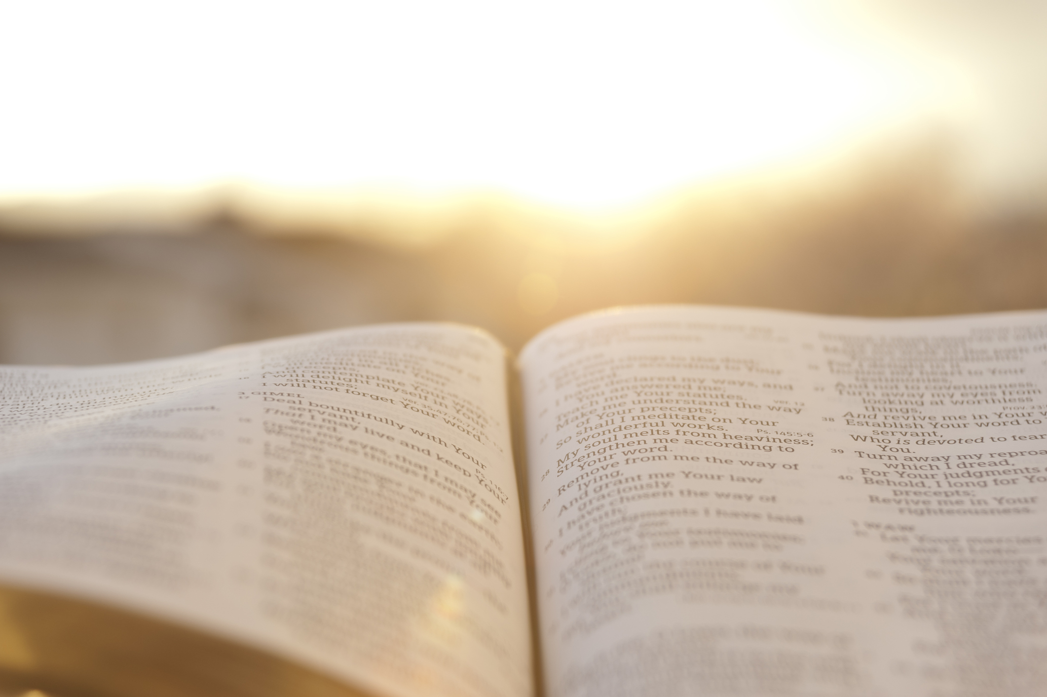open Bible with sun glow