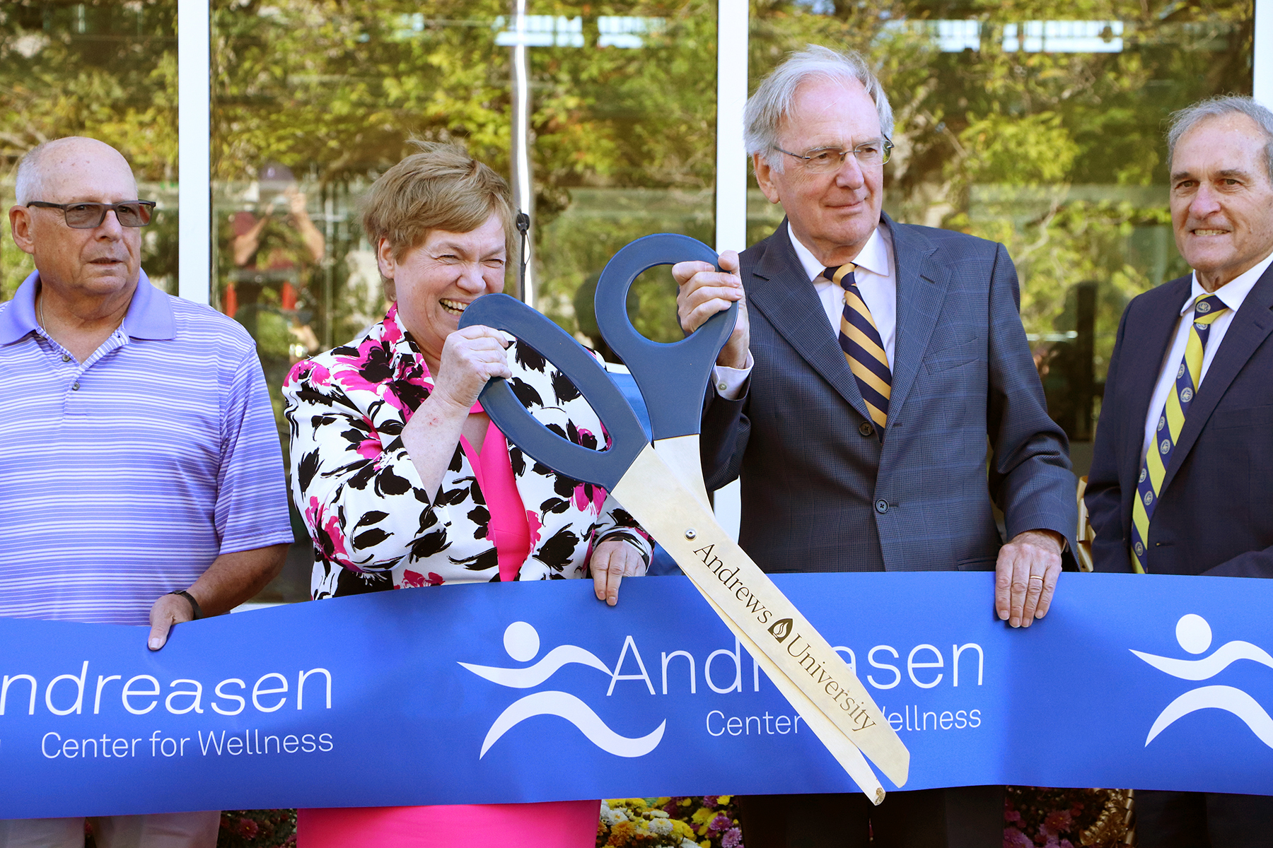 Andrews University officials prepare to cut the ribbon