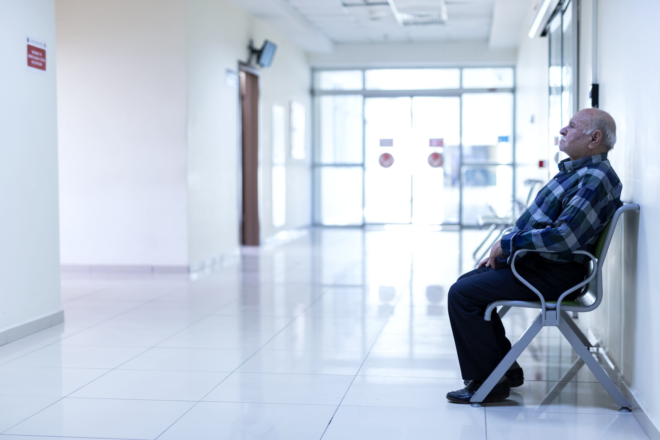 stock photo of older man in hospital waiting area