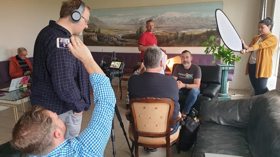 Photographers take a moment to record thoughts about their experience during the 2019 Iceland Photo Tour, a partnership with three Adventist world church divisions. Photo by Dan Weber