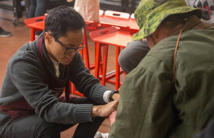LLU student started foot washing outreach