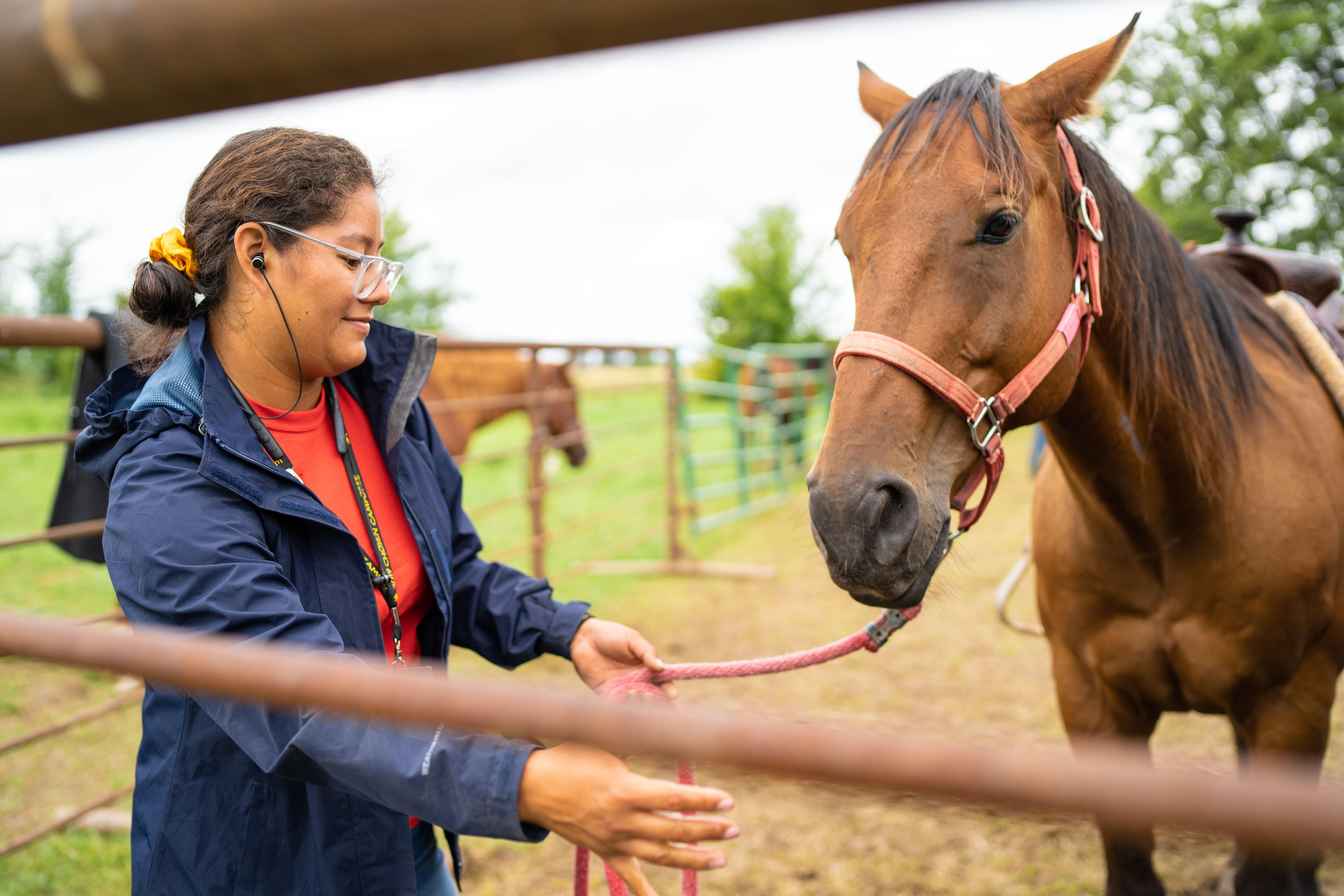 oshkosh 2019 Flor Dominguez of Keene SDA Church, in Texas leads her horse to the water. Conference: Texas Conference. Union - Southwest Union Terrence Bowen photo