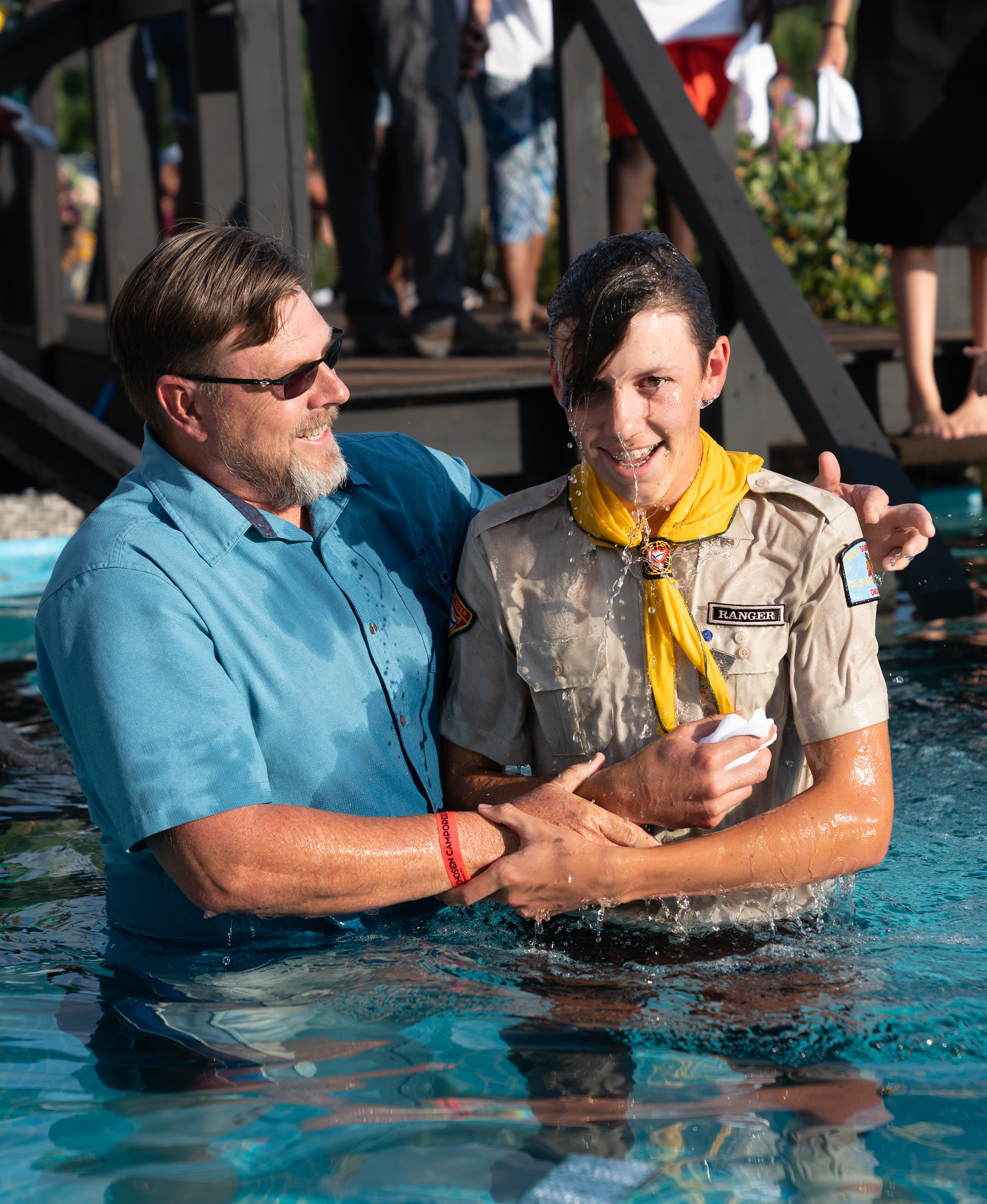 oshkosh 2019 James Bokovoy, pastor of the Okmulgee Seventh-day Adventist Church in Oklahoma, baptizes a teen Pathfinder Terrence Bowen photo