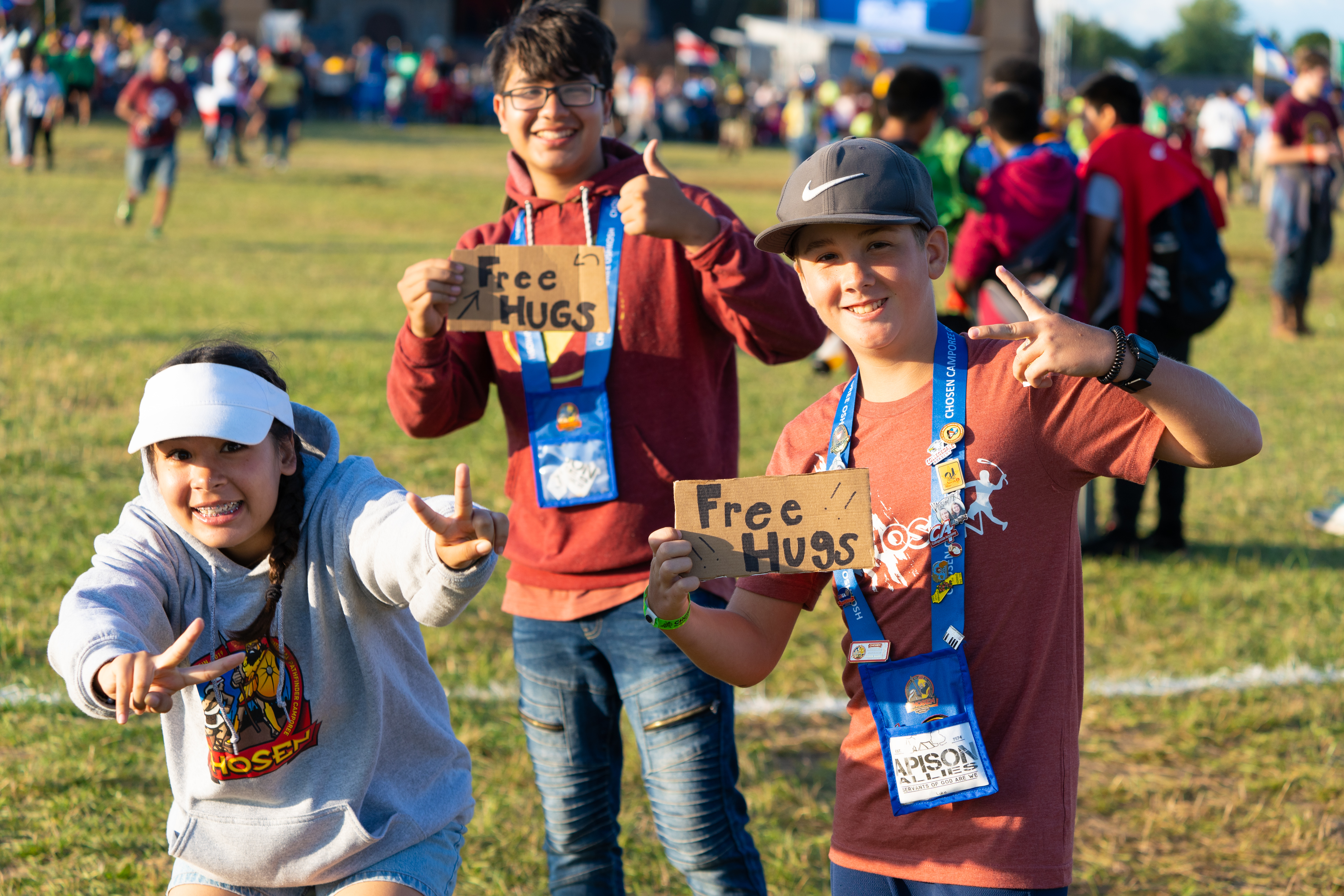While not an official Compassion Project at the camporee, these Pathfinders show compassion by offering free hugs near the main stage. Photo by Terrence Bowen