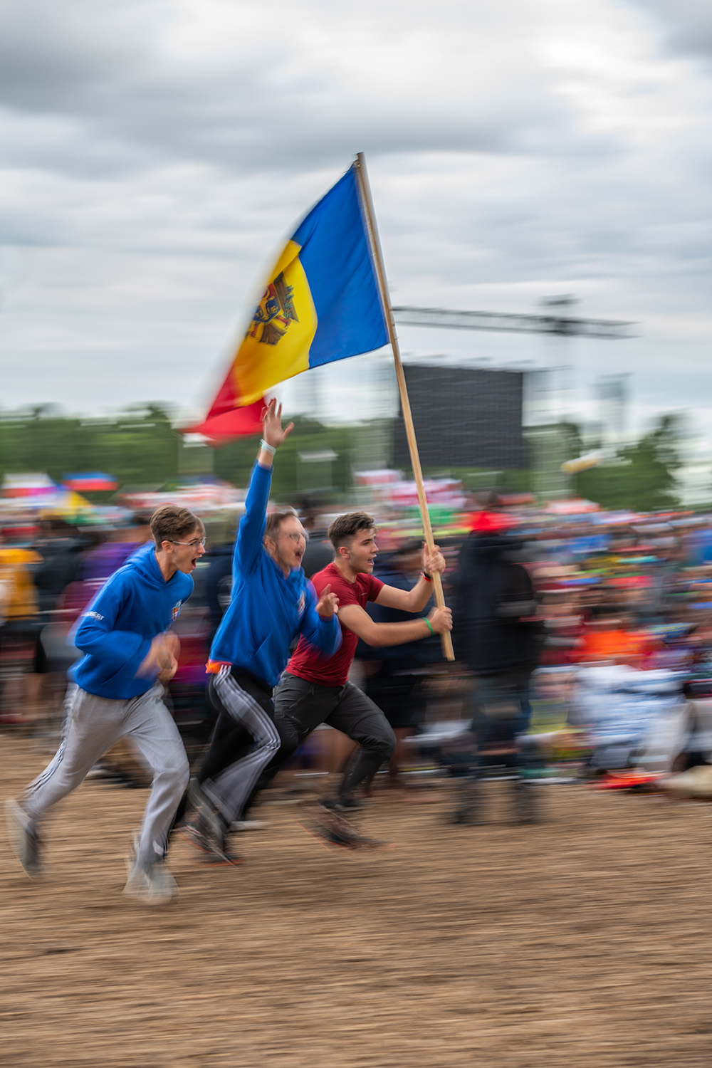 oshkosh 2019 mid res Pathfinders from Colombia run with flag before evening program James Bokovoy photo
