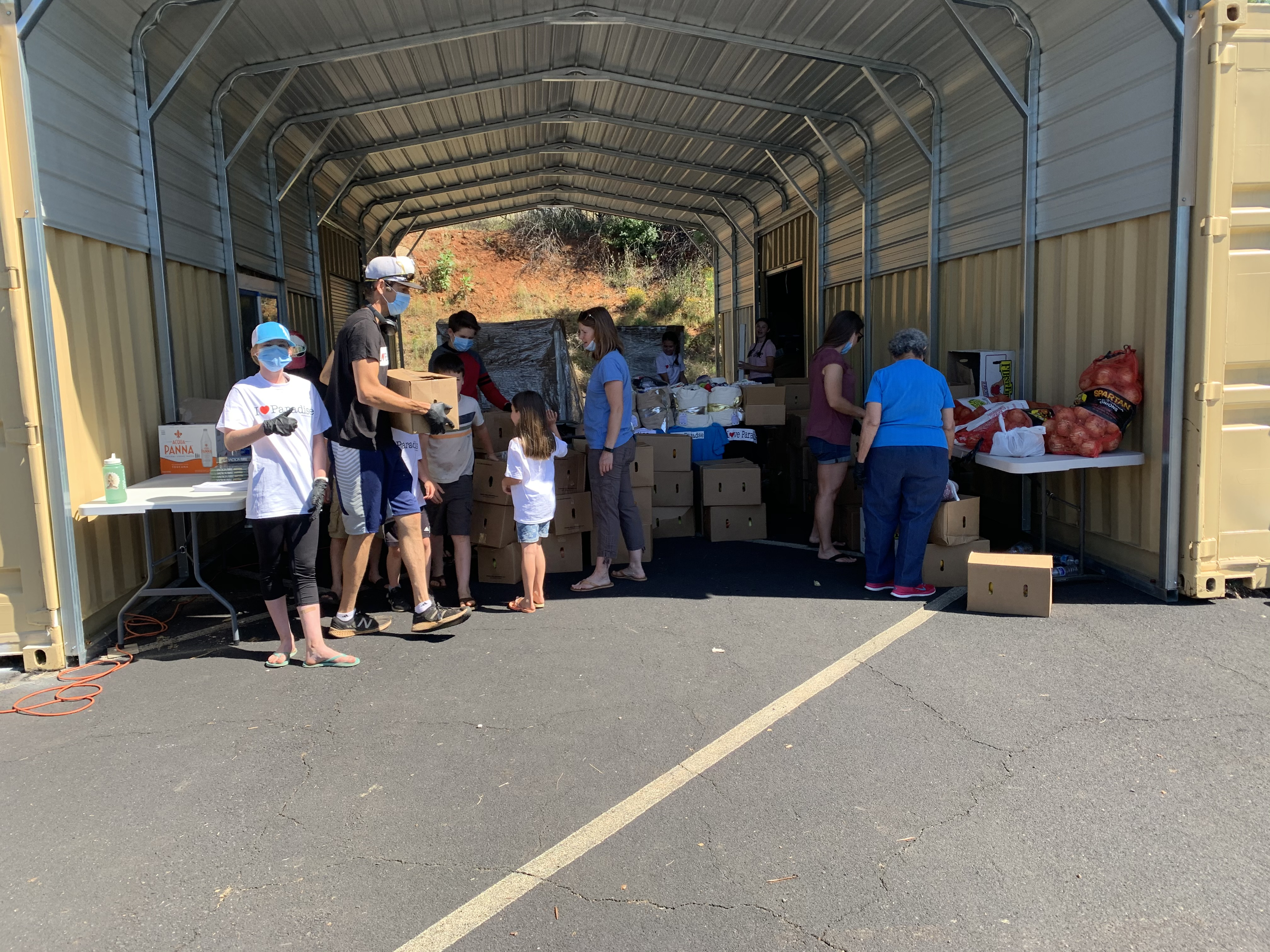 On Tuesdays, families work together filling and delivering boxes of food. Grateful to get out of the house and a safe outreach, they serve others during shelter in place.