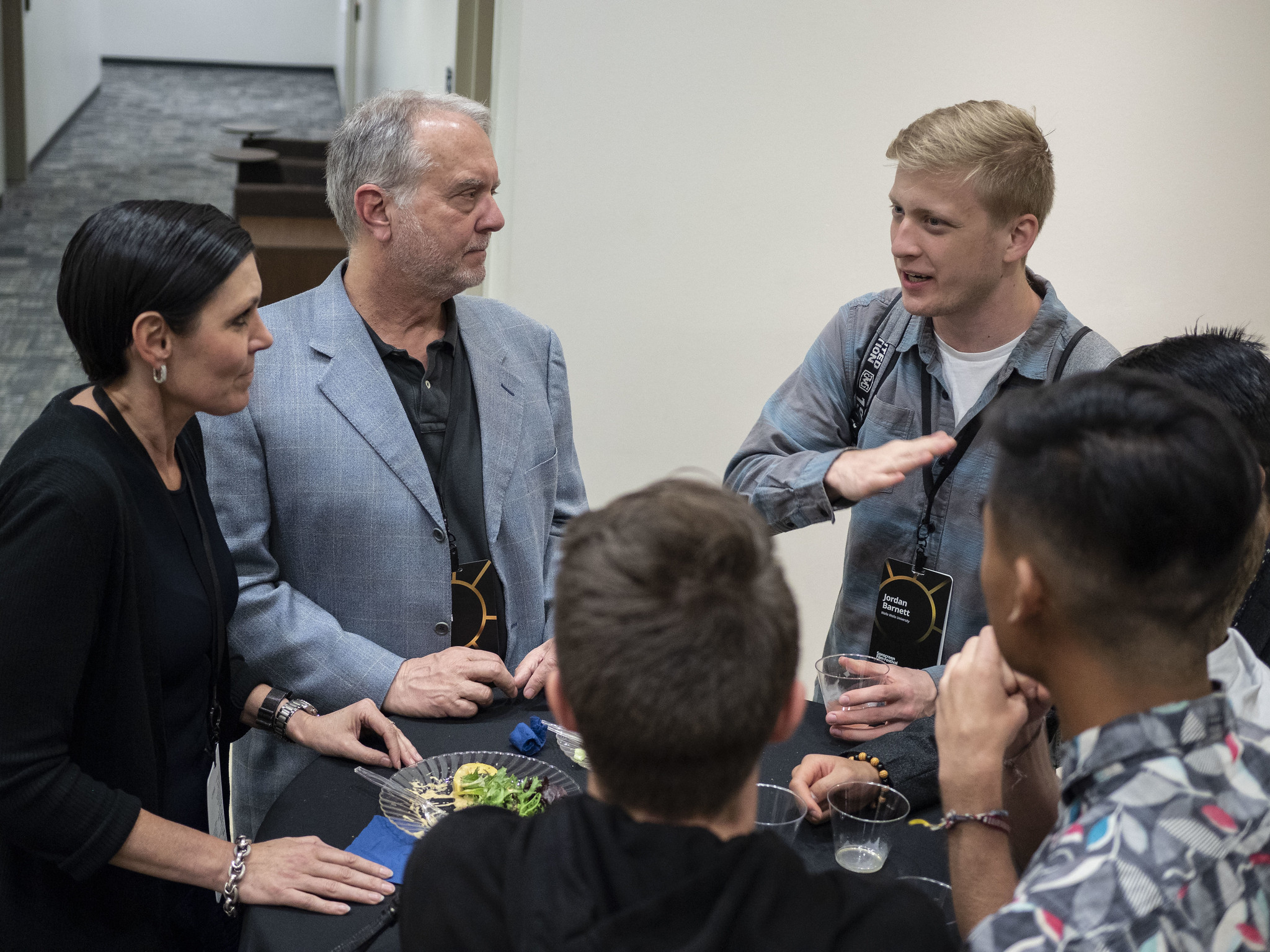 Tatia and Chris Cibelli, professional film editors, talk to student filmmakers during a meal break at the 2019 Sonscreen Film Festival.