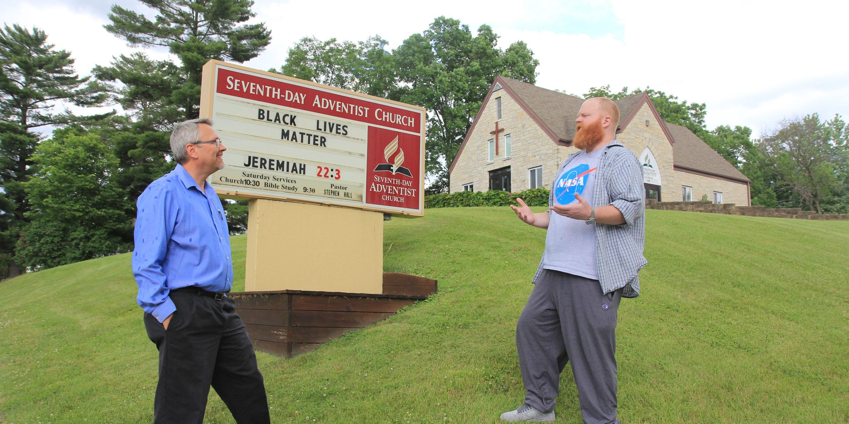 Stephen hall and church elder at Reedsburg church sign