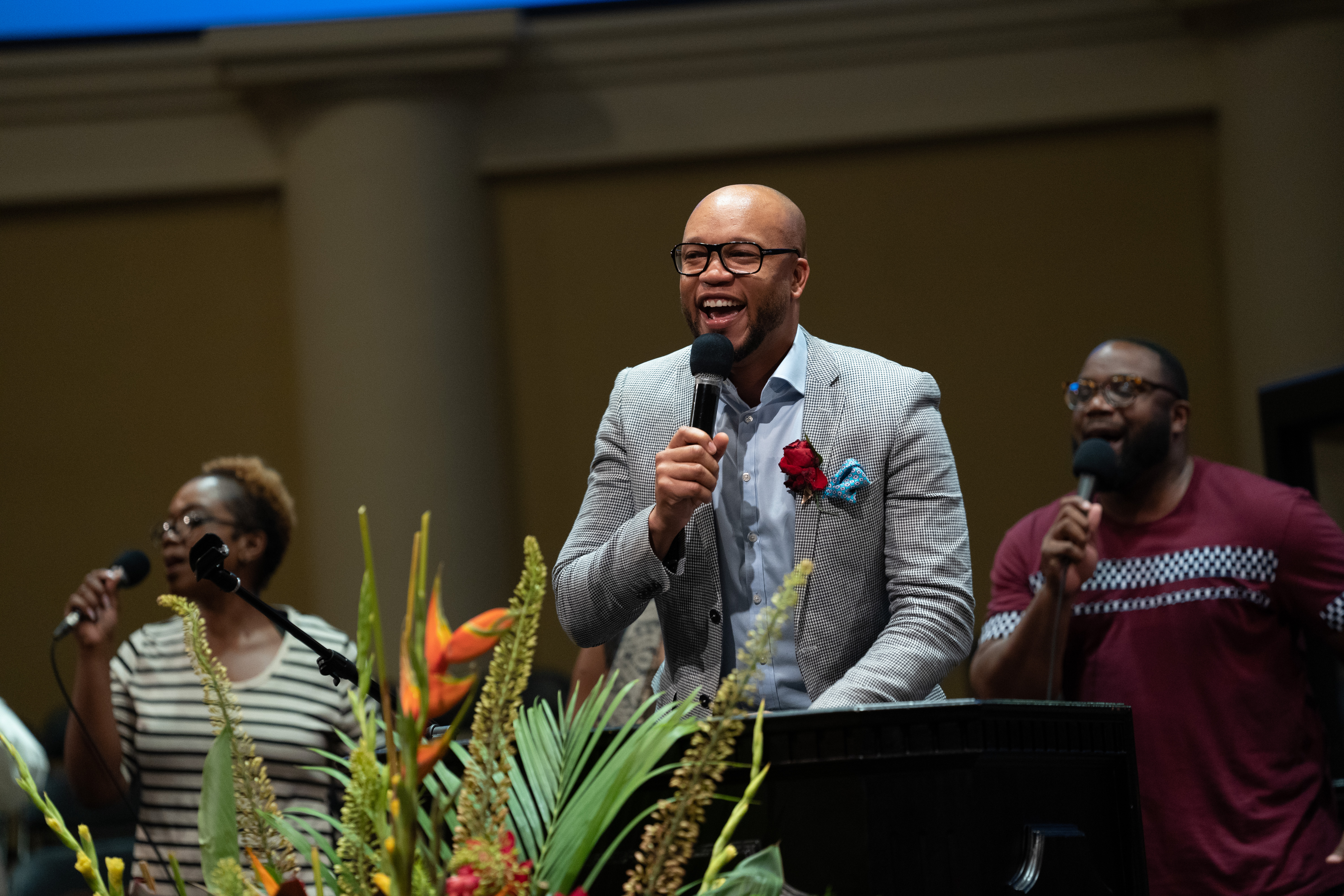 Pastor Damian Chandler of the Capitol City church leads out in praise and worship at Urban Camp Meeting.