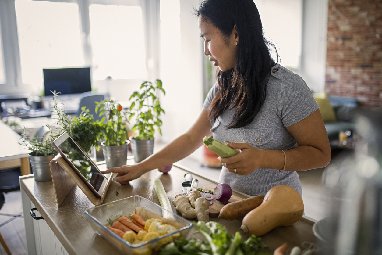stock photo of woman cooking healthful meal